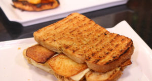 Double Decker Cheese Sandwich With Onions And Fries By Basim Akhund in Flame On Hai